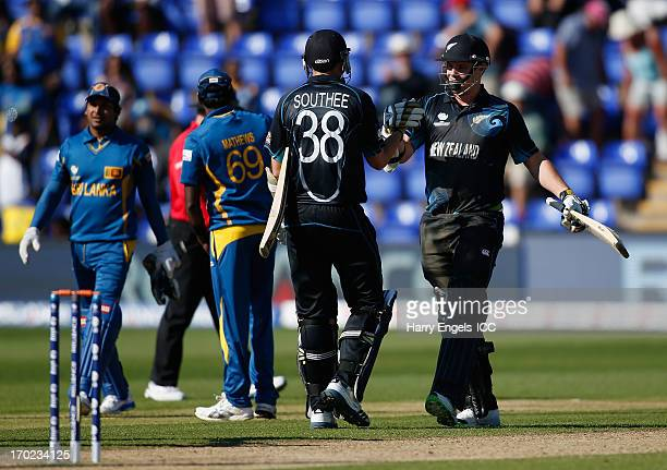 Mitchell McClenaghan and Tim Southee of New Zealand celebrate winning the match during the ICC Champions Trophy group A match between Sri Lanka and...