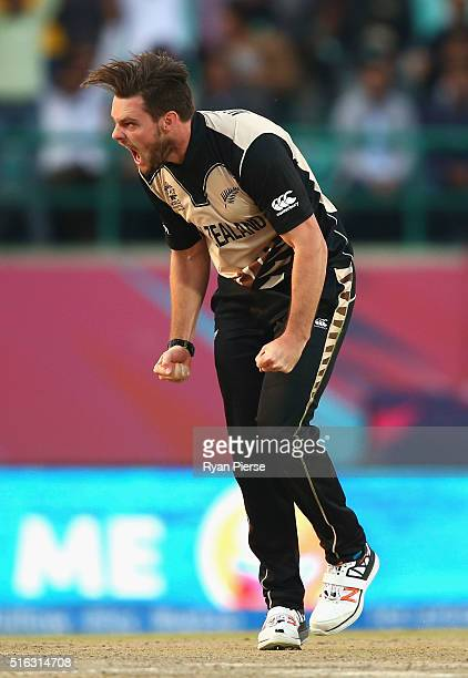 Mitchell McClenaghan of New Zealand celebrates after taking the wicket of Mitchell Marsh of Australia during the ICC World Twenty20 India 2016 Super...
