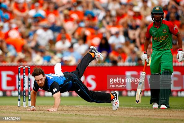 Mitchell McClenaghan of New Zealand falls while bowling during the 2015 ICC Cricket World Cup match between Bangladesh and New Zealand at Seddon Park...