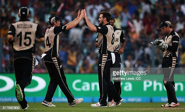 Mitchell McClenaghan of New Zealand is congratulated after bowling Mohammad Mithun of Bangladesh during the ICC World Twenty20 India 2016 match...