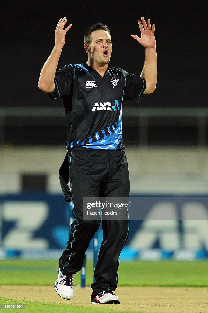 Mitchell McClenaghan of New Zealand reacts while bowling during the third Twenty20 International match between New Zealand and England at Westpac Stadium on February 15, 2013 in Wellington, New Zealand.