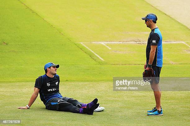 Mitchell McClenaghan of New Zealand talks with bowling coach Shane Bond during a New Zealand nets session at Eden Park on March 23 2015 in Auckland...