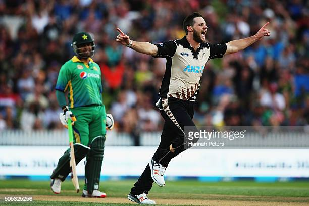 Mitchell McClenaghan of the Black Caps celebrates the wicket of Shoaib Malik of Pakistan during the International Twenty20 match between New Zealand...