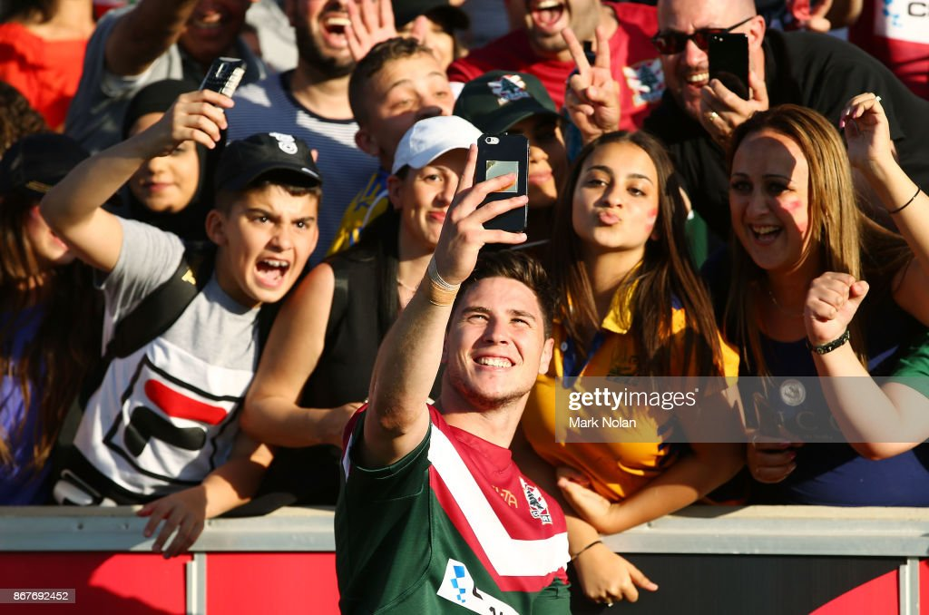 Mitchell Moses of Lebanon celebrates with fans after the 2017 Rugby League World Cup match between France and Lebanon at Canberra Stadium on October 29, 2017 in Canberra, Australia.