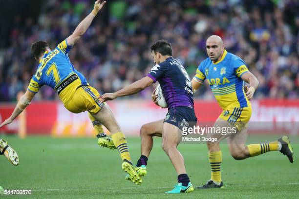 Mitchell Moses of the Eels goes flying after trying to tackle Will Chambers of the Storm during the NRL Qualifying Final match between the Melbourne...