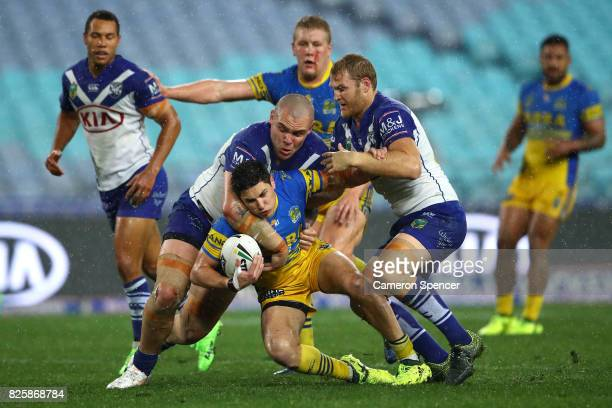 Mitchell Moses of the Eels is tackled during the round 22 NRL match between the Canterbury Bulldogs and the Parramatta Eels at ANZ Stadium on August...
