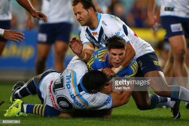 Mitchell Moses of the Eels is tackled during the round 24 NRL match between the Parramatta Eels and the Gold Coast Titans at ANZ Stadium on August 17...