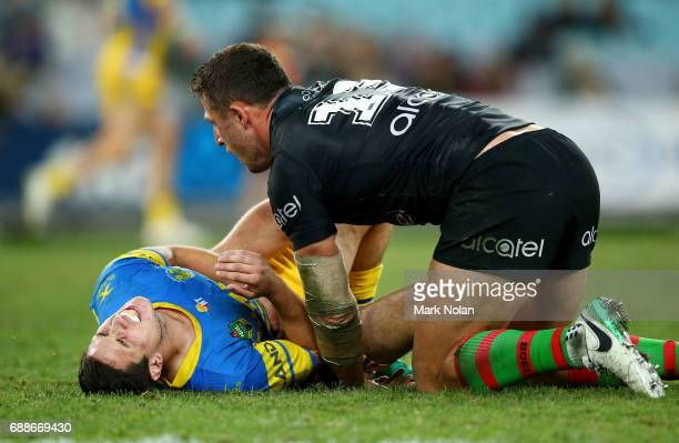 Mitchell Moses of the Eels lies injured after a tackle by Samuel Burgess of the Rabbitohs during the round 12 NRL match between the South Sydney...