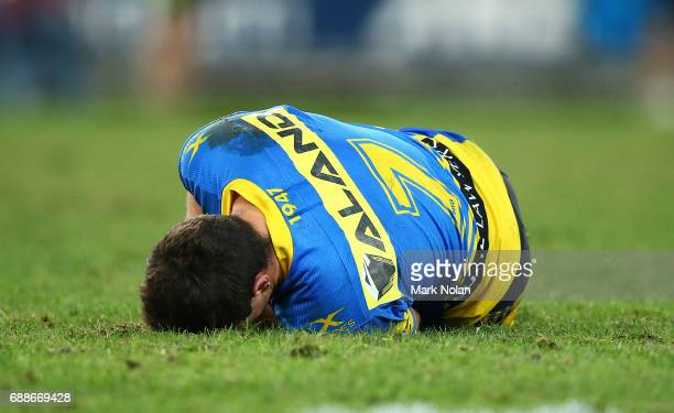 Mitchell Moses of the Eels lies injured after a tackle during the round 12 NRL match between the South Sydney Rabbitohs and the Parramatta Eels at...