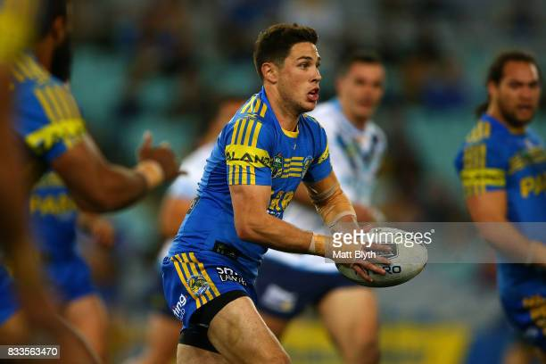 Mitchell Moses of the Eels passes the ball during the round 24 NRL match between the Parramatta Eels and the Gold Coast Titans at ANZ Stadium on...