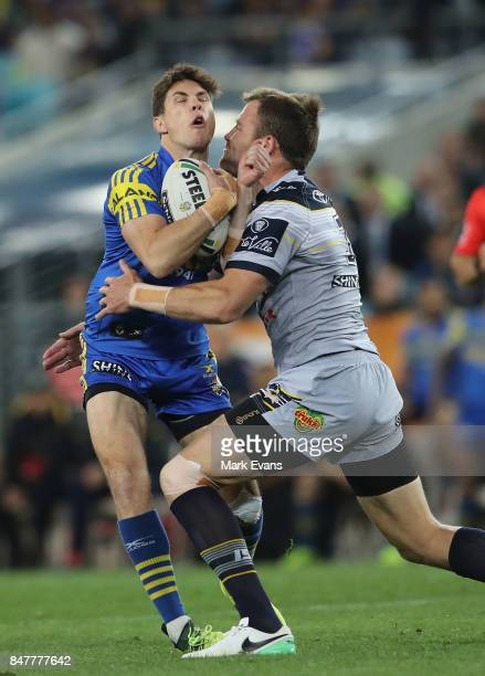 Mitchell Moses of the Eels tackled by Gavin Cooper of the Cowboys during the NRL Semi Final match between the Parramatta Eels and the North...