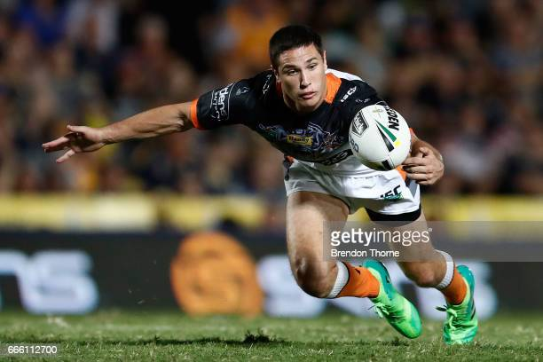 Mitchell Moses of the Tigers gathers a loose ball during the round six NRL match between the North Queensland Cowboys and the Wests Tigers at...
