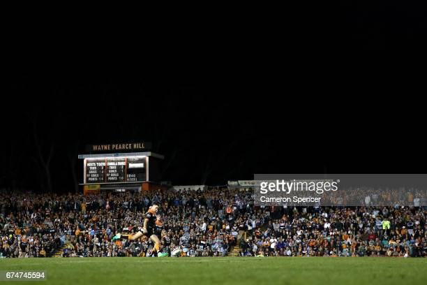 Mitchell Moses of the Tigers kicks a goal during the round nine NRL match between the Wests Tigers and the Cronulla Sharks at Leichhardt Oval on...