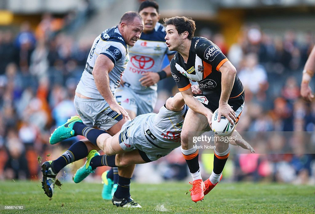 Mitchell Moses of the Tigers looks for support during the round 22 NRL match between the Wests Tigers and the North Queensland Cowboys at Leichhardt Oval on August 7, 2016 in Sydney, Australia.