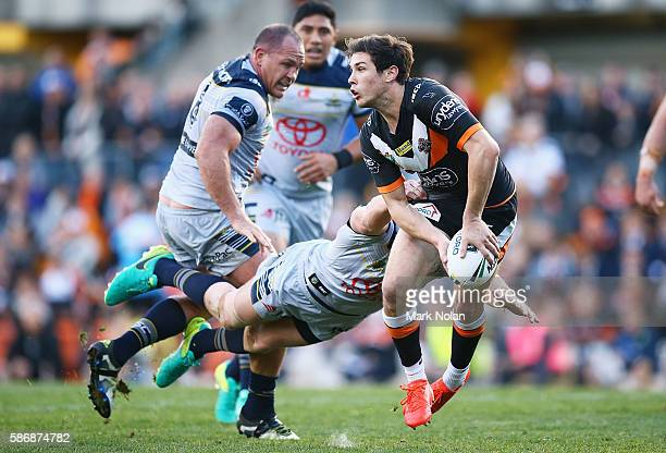 Mitchell Moses of the Tigers looks for support during the round 22 NRL match between the Wests Tigers and the North Queensland Cowboys at Leichhardt...