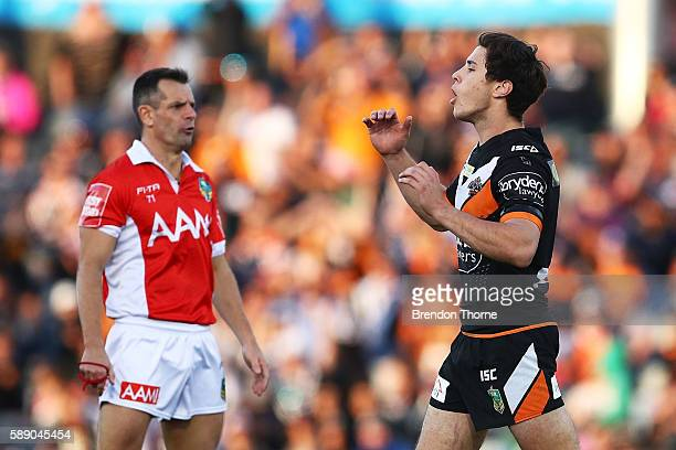 Mitchell Moses of the Tigers reacts after missing a field goal during the round 23 NRL match between the Wests Tigers and the Gold Coast Titans at...
