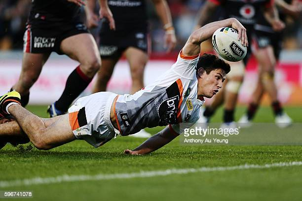 Mitchell Moses of the Tigers scores a try during the round 25 NRL match between the New Zealand Warriors and the Wests Tigers at Mount Smart Stadium...