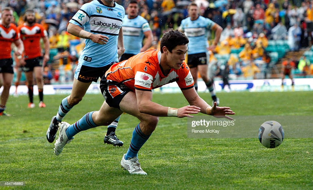 Mitchell Moses of the Tigers scores a try during the round 26 NRL match between the Wests Tigers and the Cronulla Sharks at Leichhardt Oval on September 6, 2014 in Sydney, Australia.