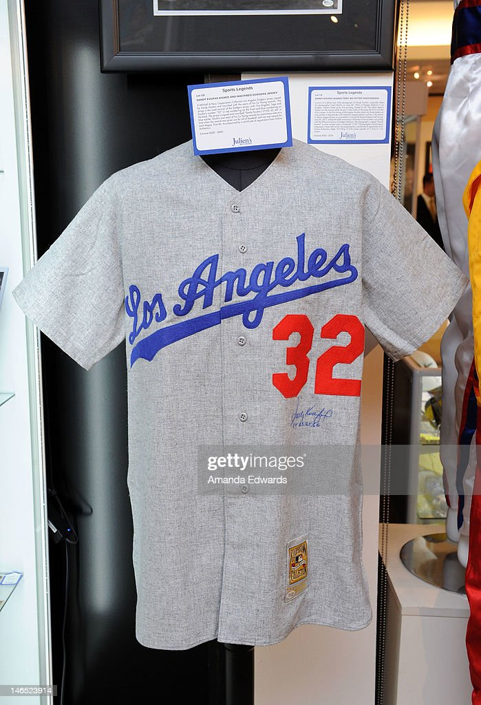 A Mitchell & Ness Cooperstown Collection Los Angeles Dodgers jersey signed by <a gi-track='captionPersonalityLinkClicked' href=/galleries/search?phrase=Sandy+Koufax&family=editorial&specificpeople=94045 ng-click='$event.stopPropagation()'>Sandy Koufax</a> is displayed at the Julien's Auctions press call for Music Icons And Sports Legends Memorabilia Auction at Julien's Auctions Gallery on June 18, 2012 in Beverly Hills, California.