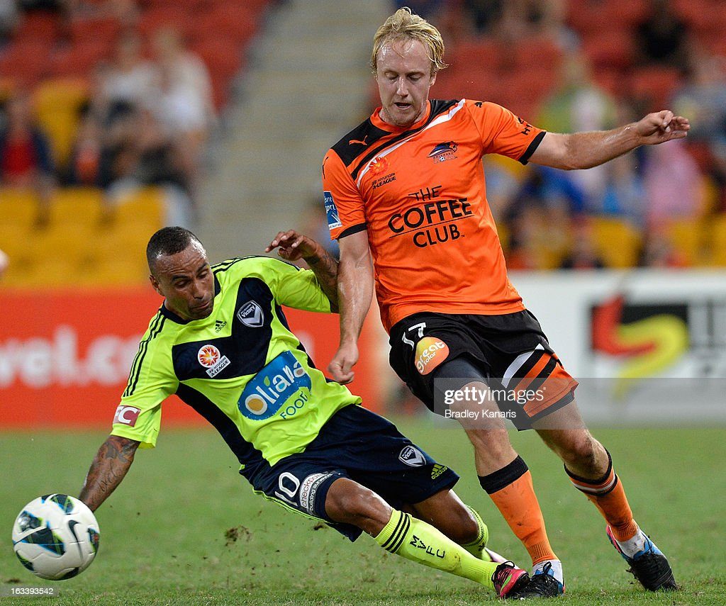 Mitchell Nichols of the Roar is tackled by <a gi-track='captionPersonalityLinkClicked' href=/galleries/search?phrase=Archie+Thompson&family=editorial&specificpeople=545649 ng-click='$event.stopPropagation()'>Archie Thompson</a> of the Victory during the round 24 A-League match between the Brisbane Roar and the Melbourne Victory at Suncorp Stadium on March 9, 2013 in Brisbane, Australia.