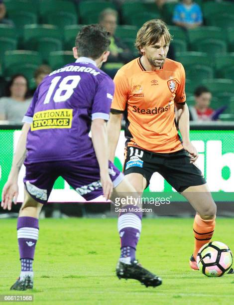 Mitchell Oxborrow of the Glory and Brett Holman of the Roar compete for the ball during the round 26 ALeague match between the Perth Glory and...