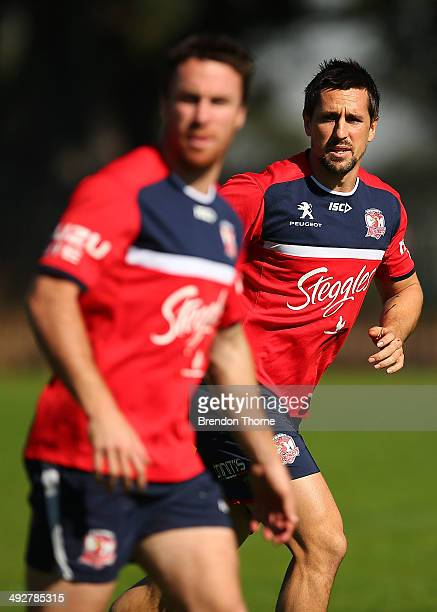 Mitchell Pearce and James Maloney of the Roosters run drills during a Sydney Roosters NRL training session at Kippax Lake on May 22 2014 in Sydney...