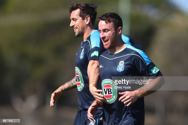 Mitchell Pearce and James Maloney run during a New South Wales Blues State of Origin training session at Cudgen Leagues Club on May 25 2017 in...