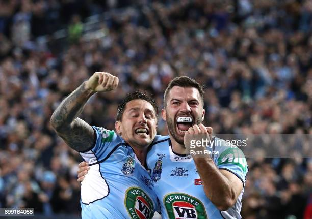 Mitchell Pearce and James Tedesco of the Blues celebrate after Pearce scored a try during game two of the State Of Origin series between the New...