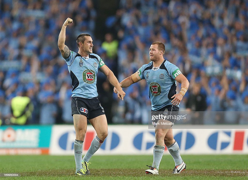 <a gi-track='captionPersonalityLinkClicked' href=/galleries/search?phrase=Mitchell+Pearce&family=editorial&specificpeople=4208962 ng-click='$event.stopPropagation()'>Mitchell Pearce</a> and Trent Merrin of the Blues celebrate victory during game one of the ARL State of Origin series between the New South Wales Blues and the Queensland Maroons at ANZ Stadium on June 5, 2013 in Sydney, Australia.
