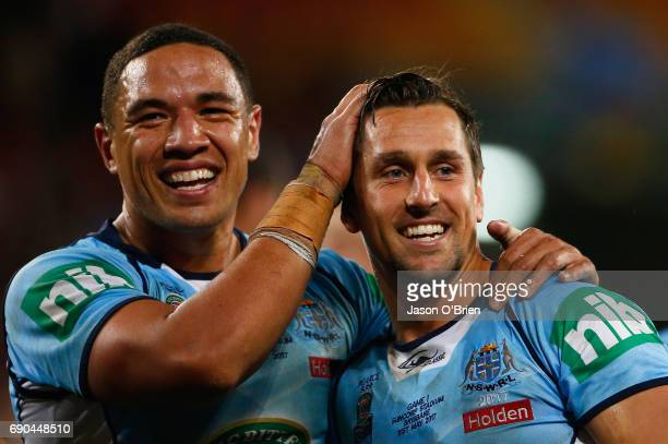Mitchell Pearce and Tyson Frizell of the Blues celebrate during game one of the State Of Origin series between the Queensland Maroons and the New...