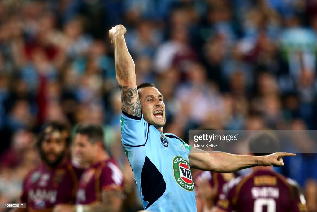 <a gi-track='captionPersonalityLinkClicked' href=/galleries/search?phrase=Mitchell+Pearce&family=editorial&specificpeople=4208962 ng-click='$event.stopPropagation()'>Mitchell Pearce</a> of the Blues celebrates winning game one of the ARL State of Origin series between the New South Wales Blues and the Queensland Maroons at ANZ Stadium on June 5, 2013 in Sydney, Australia.