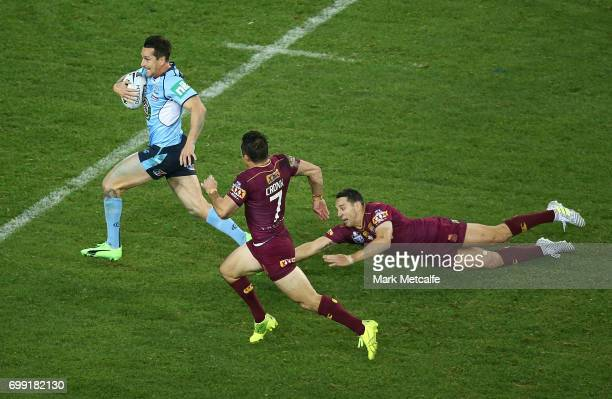 Mitchell Pearce of the Blues makes a break to score a try during game two of the State Of Origin series between the New South Wales Blues and the...