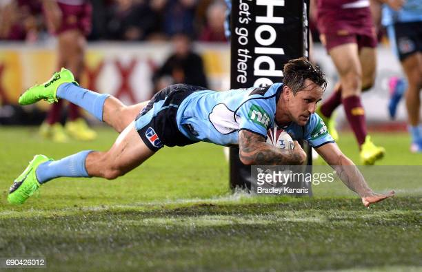 Mitchell Pearce of the Blues scores a try during game one of the State Of Origin series between the Queensland Maroons and the New South Wales Blues...