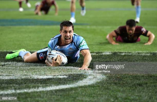Mitchell Pearce of the Blues scores a try during game two of the State Of Origin series between the New South Wales Blues and the Queensland Maroons...