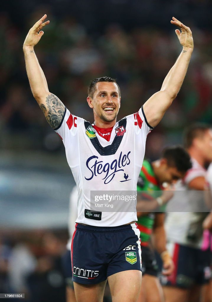 <a gi-track='captionPersonalityLinkClicked' href=/galleries/search?phrase=Mitchell+Pearce&family=editorial&specificpeople=4208962 ng-click='$event.stopPropagation()'>Mitchell Pearce</a> of the Roosters celebrates after the fulltime during the round 26 NRL match between the South Sydney Rabbitohs and the Sydney Roosters at ANZ Stadium on September 6, 2013 in Sydney, Australia.