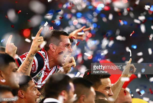 Mitchell Pearce of the Roosters celebrates victory after the 2013 NRL Grand Final match between the Sydney Roosters and the Manly Warringah Sea...