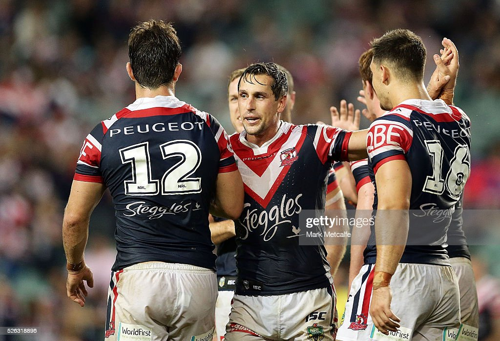 <a gi-track='captionPersonalityLinkClicked' href=/galleries/search?phrase=Mitchell+Pearce&family=editorial&specificpeople=4208962 ng-click='$event.stopPropagation()'>Mitchell Pearce</a> of the Roosters celebrates with team mates following a try during the round nine NRL match between the Sydney Roosters and the Newcastle Knights at Allianz Stadium on April 30, 2016 in Sydney, Australia.