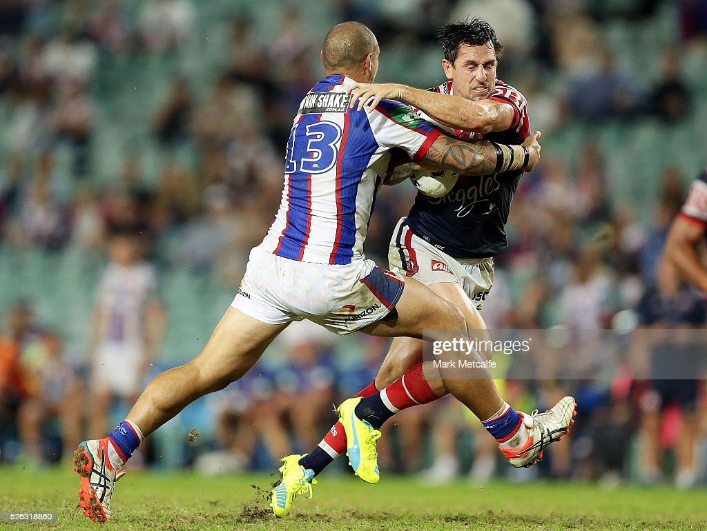 Mitchell Pearce of the Roosters is tackled by Jeremy Smith of the Knights during the round nine NRL match between the Sydney Roosters and the Newcastle Knights at Allianz Stadium on April 30, 2016 in Sydney, Australia.