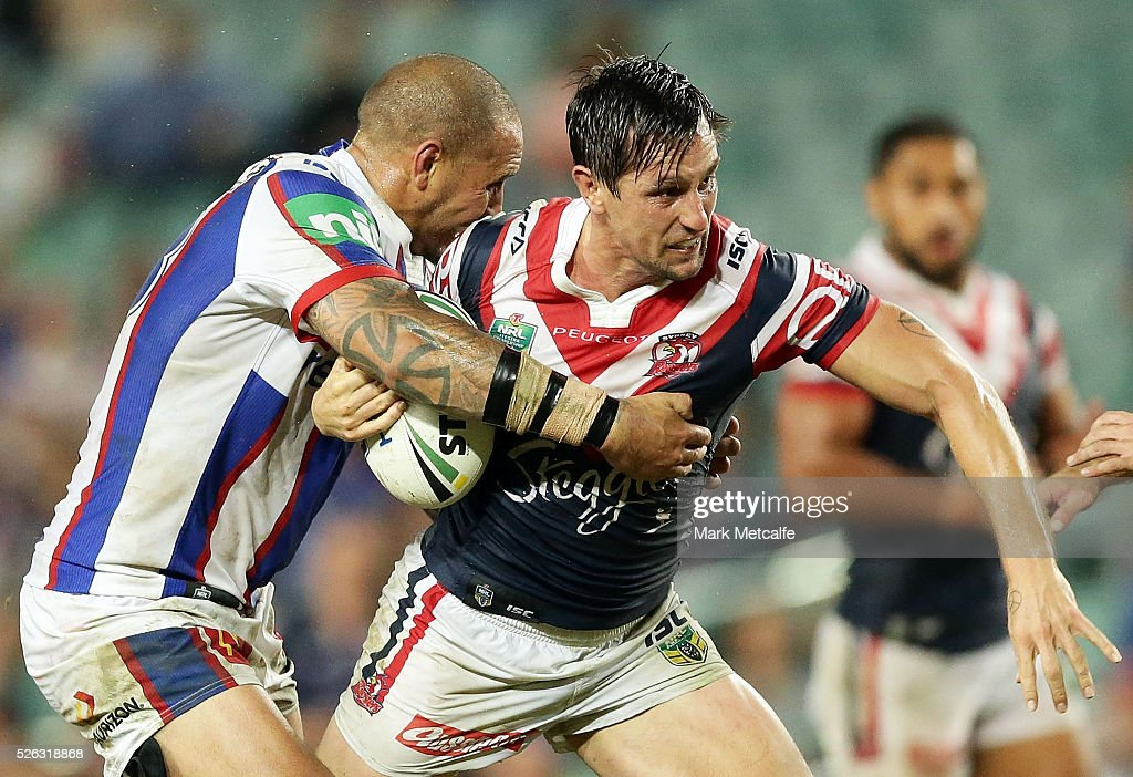 <a gi-track='captionPersonalityLinkClicked' href=/galleries/search?phrase=Mitchell+Pearce&family=editorial&specificpeople=4208962 ng-click='$event.stopPropagation()'>Mitchell Pearce</a> of the Roosters is tackled by Jeremy Smith of the Knights during the round nine NRL match between the Sydney Roosters and the Newcastle Knights at Allianz Stadium on April 30, 2016 in Sydney, Australia.