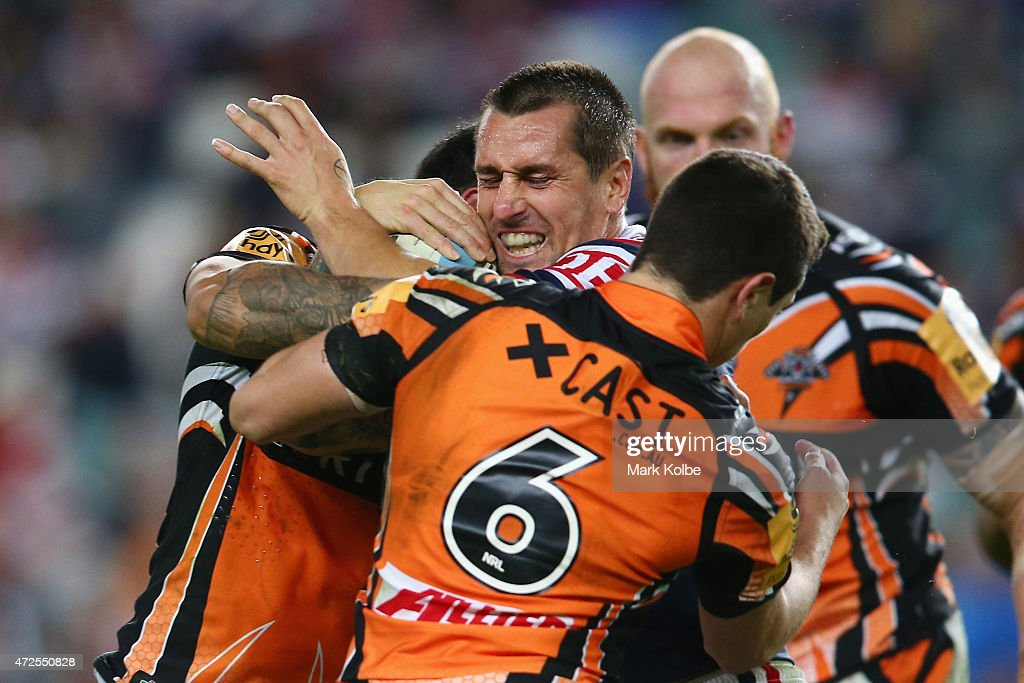 Mitchell Pearce of the Roosters is tackled during the round nine NRL match between the Sydney Roosters and the Wests Tigers at Allianz Stadium on May 8, 2015 in Sydney, Australia.