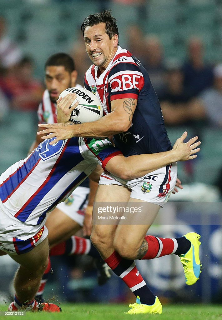 <a gi-track='captionPersonalityLinkClicked' href=/galleries/search?phrase=Mitchell+Pearce&family=editorial&specificpeople=4208962 ng-click='$event.stopPropagation()'>Mitchell Pearce</a> of the Roosters is tackled during the round nine NRL match between the Sydney Roosters and the Newcastle Knights at Allianz Stadium on April 30, 2016 in Sydney, Australia.