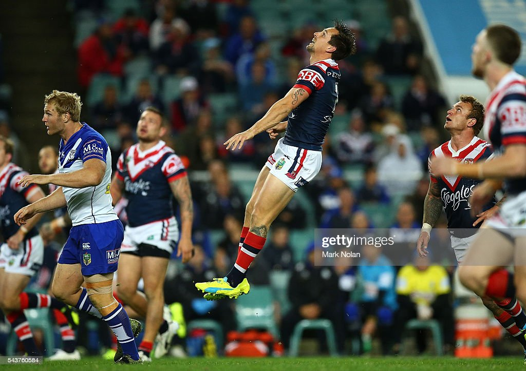 <a gi-track='captionPersonalityLinkClicked' href=/galleries/search?phrase=Mitchell+Pearce&family=editorial&specificpeople=4208962 ng-click='$event.stopPropagation()'>Mitchell Pearce</a> of the Roosters kicks ahead during the round 17 NRL match between the Sydney Roosters and the Canterbury Bulldogs at Allianz Stadium on June 30, 2016 in Sydney, Australia.