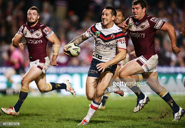 Mitchell Pearce of the Roosters makes a break during the round 16 NRL match between the Manly Warringah Sea Eagles and the Sydney Roosters at...