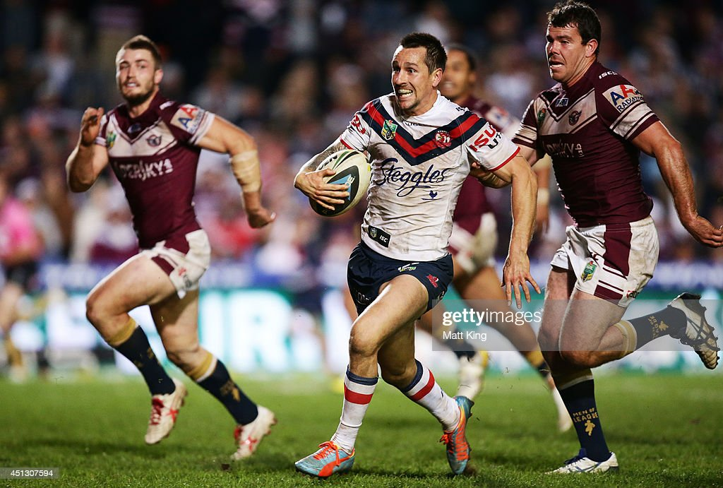 <a gi-track='captionPersonalityLinkClicked' href=/galleries/search?phrase=Mitchell+Pearce&family=editorial&specificpeople=4208962 ng-click='$event.stopPropagation()'>Mitchell Pearce</a> of the Roosters makes a break during the round 16 NRL match between the Manly Warringah Sea Eagles and the Sydney Roosters at Brookvale Oval on June 27, 2014 in Sydney, Australia.