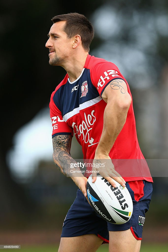 <a gi-track='captionPersonalityLinkClicked' href=/galleries/search?phrase=Mitchell+Pearce&family=editorial&specificpeople=4208962 ng-click='$event.stopPropagation()'>Mitchell Pearce</a> of the Roosters passes during a Sydney Roosters NRL training session at Kippax Lake on September 3, 2014 in Sydney, Australia.