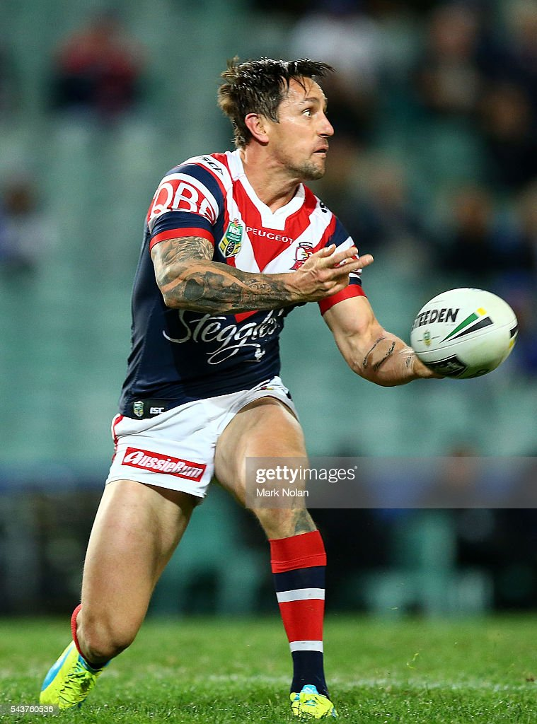 <a gi-track='captionPersonalityLinkClicked' href=/galleries/search?phrase=Mitchell+Pearce&family=editorial&specificpeople=4208962 ng-click='$event.stopPropagation()'>Mitchell Pearce</a> of the Roosters passes during the round 17 NRL match between the Sydney Roosters and the Canterbury Bulldogs at Allianz Stadium on June 30, 2016 in Sydney, Australia.