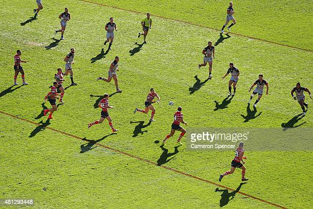 Mitchell Pearce of the Roosters passes during the round 19 NRL match between the Sydney Roosters and the New Zealand Warriors at Allianz Stadium on...
