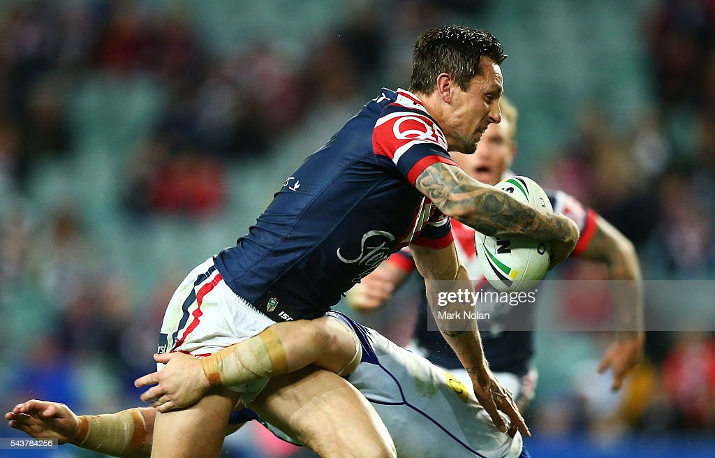 <a gi-track='captionPersonalityLinkClicked' href=/galleries/search?phrase=Mitchell+Pearce&family=editorial&specificpeople=4208962 ng-click='$event.stopPropagation()'>Mitchell Pearce</a> of the Roosters runs the ball during the round 17 NRL match between the Sydney Roosters and the Canterbury Bulldogs at Allianz Stadium on June 30, 2016 in Sydney, Australia.