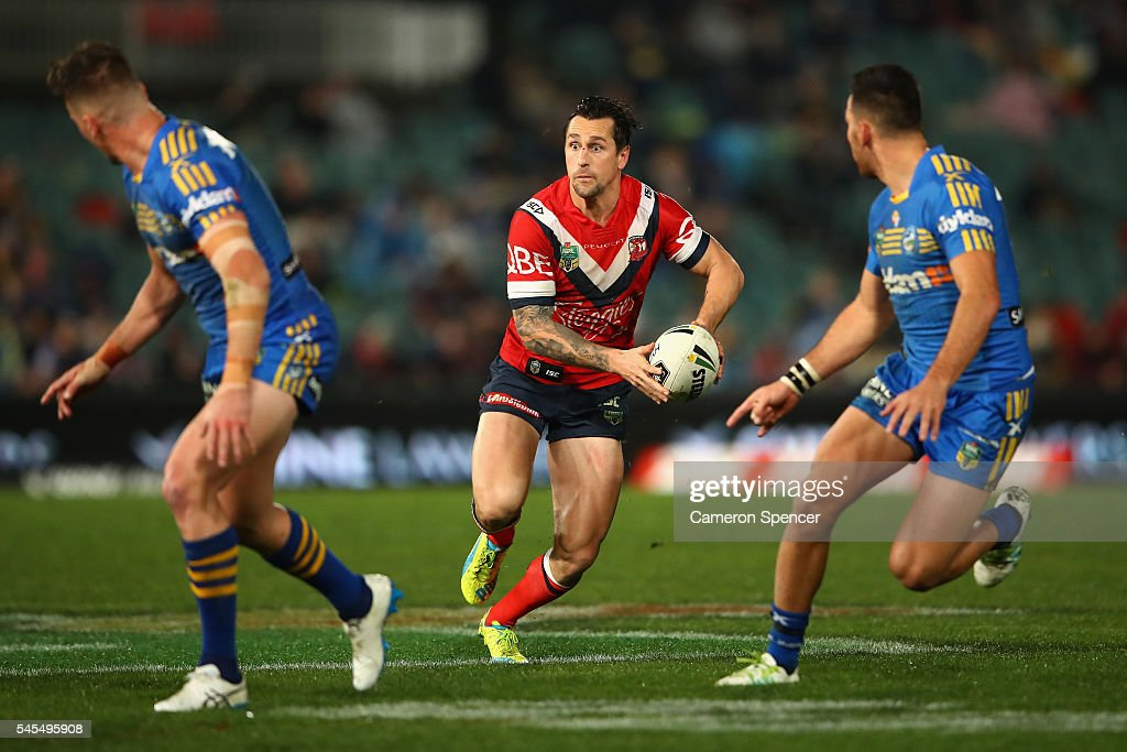Mitchell Pearce of the Roosters runs the ball during the round 18 NRL match between the Parramatta Eels and the Sydney Roosters at Pirtek Stadium on July 8, 2016 in Sydney, Australia.