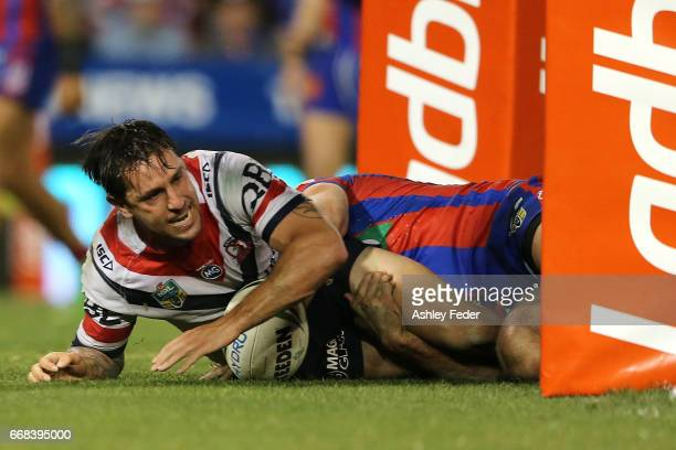 Mitchell Pearce of the Roosters scores a try during the round seven NRL match between the Newcastle Knights and the Sydney Roosters at McDonald Jones...